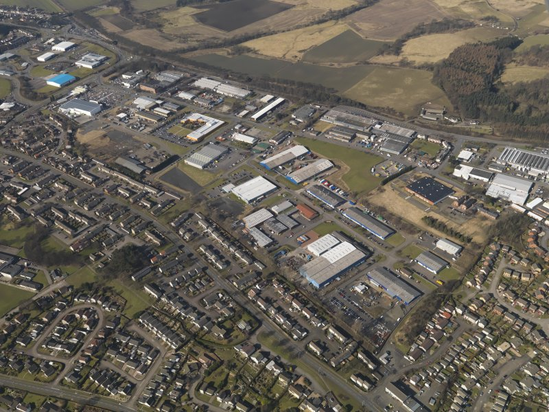 General oblique aerial view centred on the industrial estates, taken from the SE.