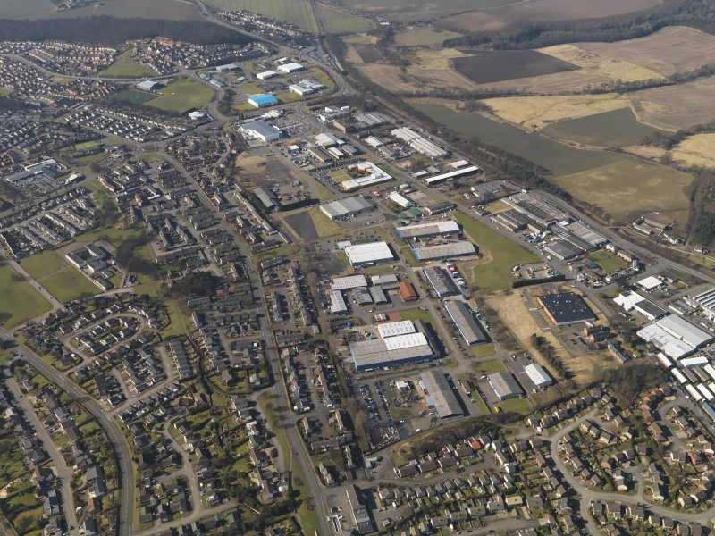 General oblique aerial view centred on the industrial estates, taken from the E.