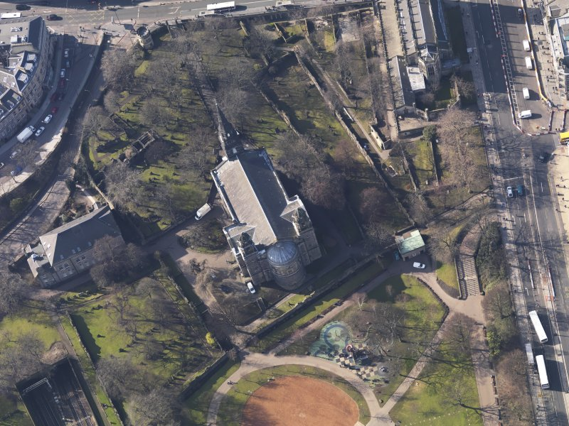 Oblique aerial view centred on the church, taken from the E.