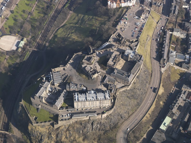 General oblique aerial view centred on the castle, taken from the SW.
