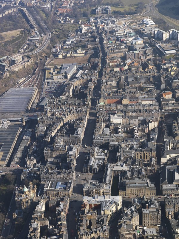 General oblique aerial view centred on the High Street, taken from the W.