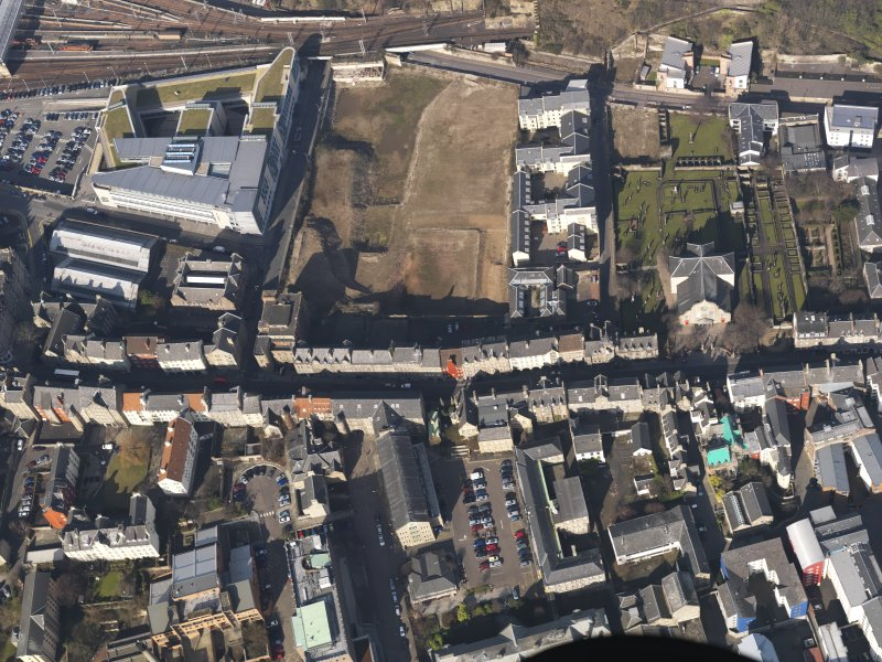 General oblique aerial view centred on the High Street and Canongate, taken from the SSE.