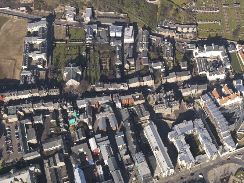 General oblique aerial view centred on the Canongate, taken from the SSE.