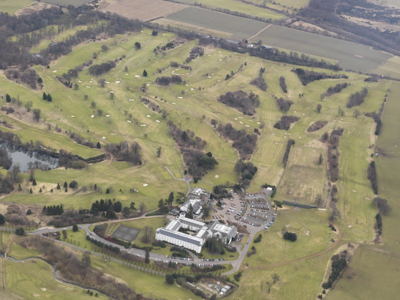General oblique aerial view centred on Dalmahoy House with the country club adjacent from the NW.
