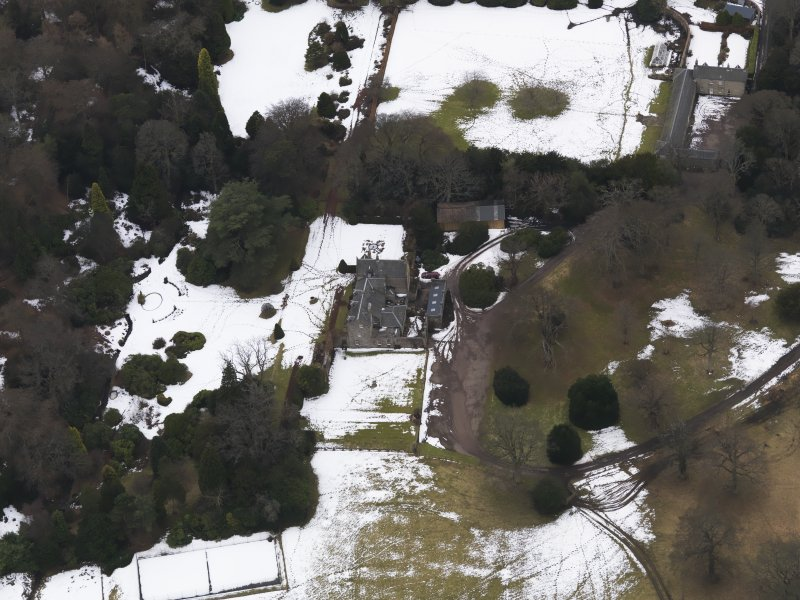 Oblique aerial view centred on the country house, taken from the NE.