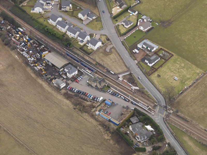 Oblique aerial view centred on the railway station, taken from the NW.