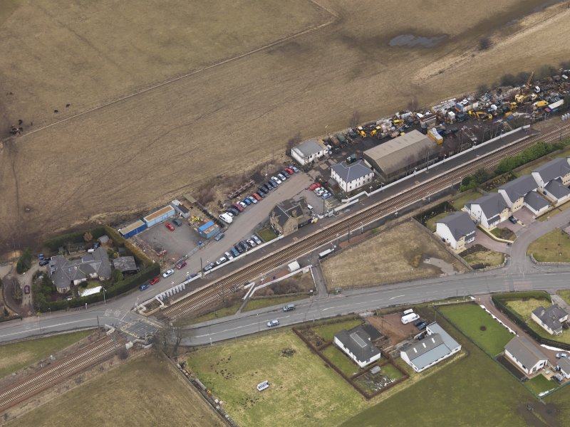 Oblique aerial view centred on the railway station, taken from the SW.