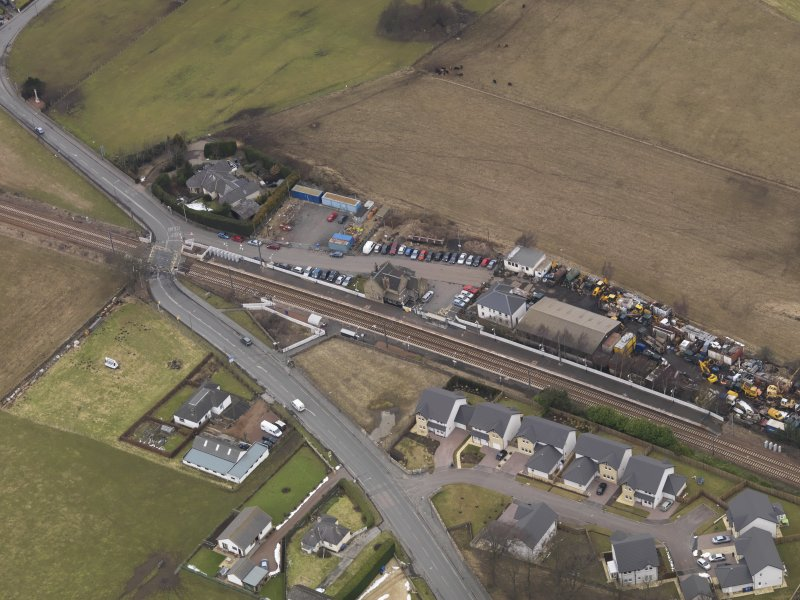 Oblique aerial view centred on the railway station, taken from the SE.
