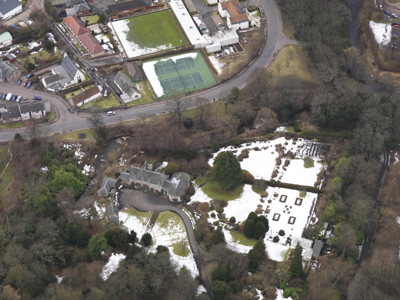 Oblique aerial view centred on the house, taken from the ENE.