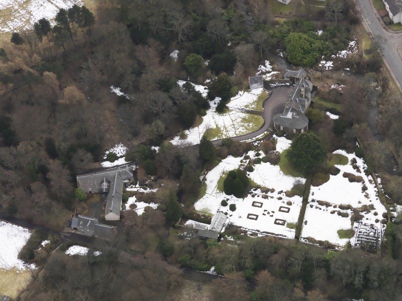 Oblique aerial view centred on the house, taken from the N.