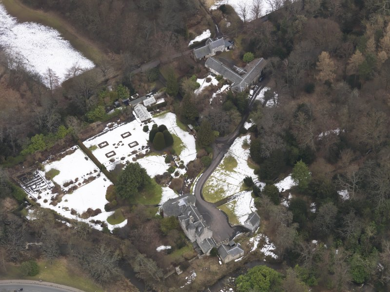Oblique aerial view centred on the house, taken from the SW.
