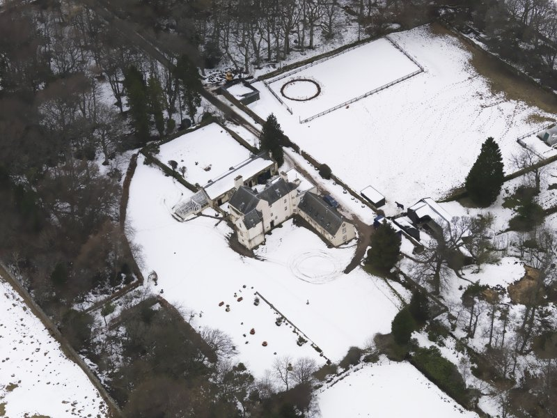 Oblique aerial view centred on the fortified house, taken from the SE.