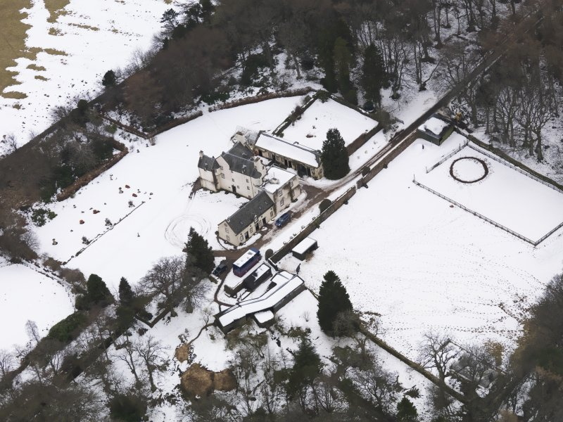 Oblique aerial view centred on the fortified house, taken from the  NE.