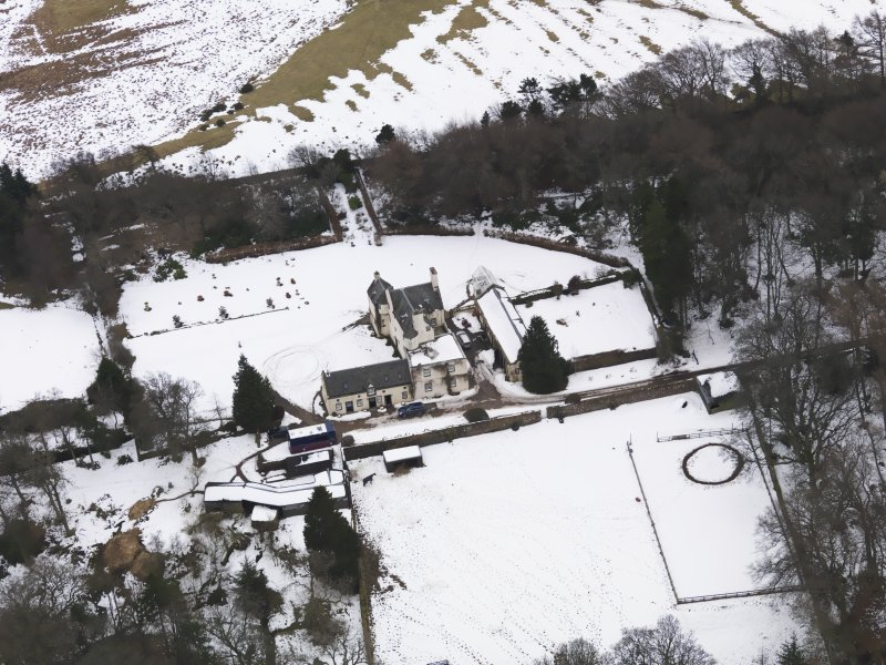 Oblique aerial view centred on the fortified house, taken from the N.