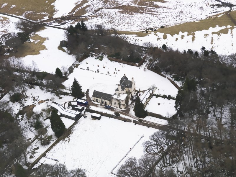 Oblique aerial view centred on the fortified house, taken from the NW.