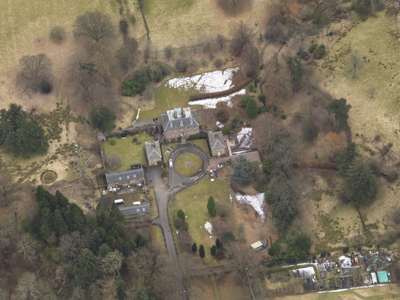 Oblique aerial view centred on the country house with the stable block, taken from the NNW.