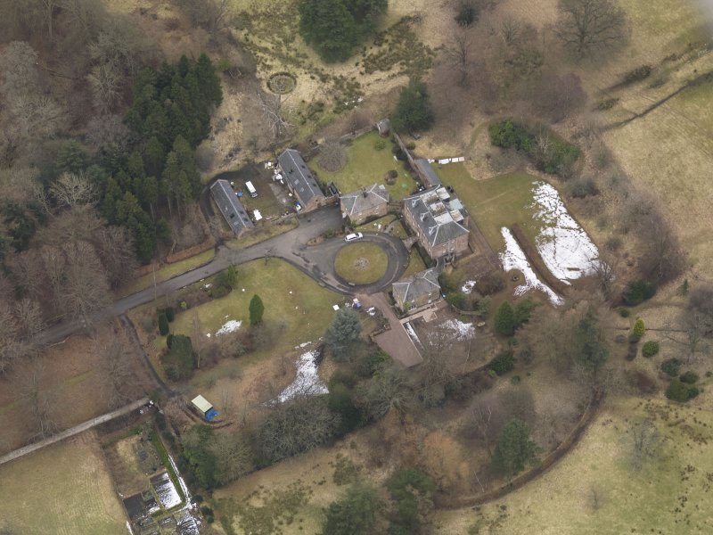 Oblique aerial view centred on the country house with the stable block, taken from the WNW.