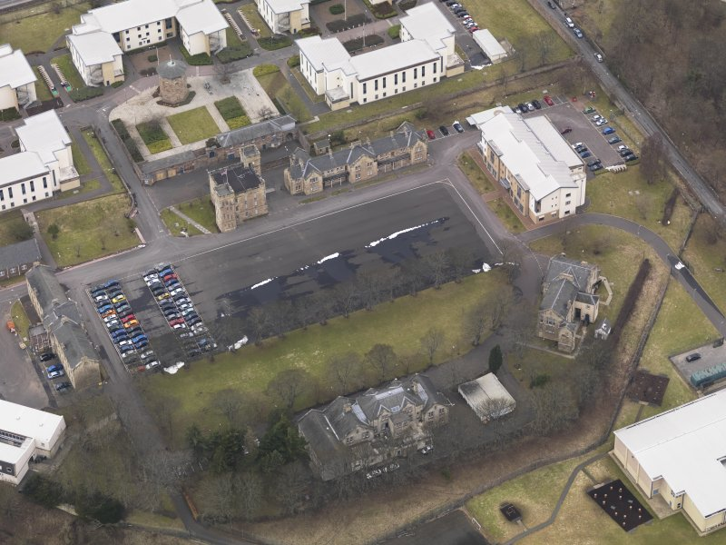 Oblique aerial view centred on the barracks, taken from the SE.