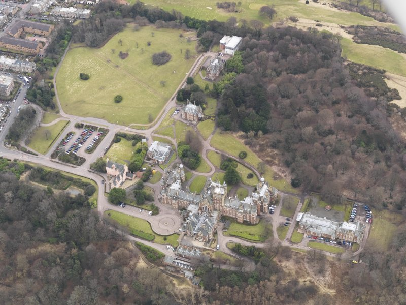 Oblique aerial view centred on the hospital/University, taken from the NW.