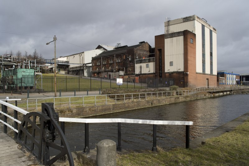 Tun room, spirit receivers and still house, view from canal bridge to S. The Forth and Clyde Canal style bascule bridge is at the extreme left of image.