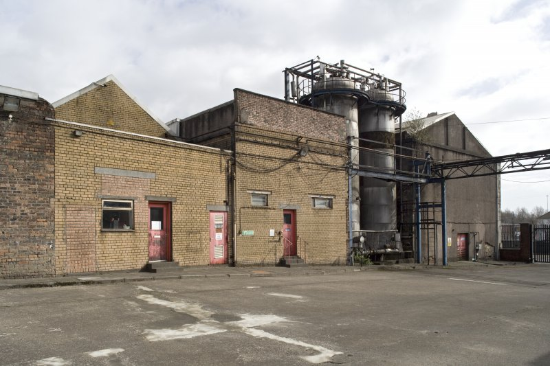 CO2 plant, view from NW. This is the site of what was a separate industrial site of the early 19th century, The Eagle Foundry. The surviving building of the Eahle Foundry is on the extreme right. Note that the harl on the wall has come away revealing the early 19th century masonry wall beneath.
