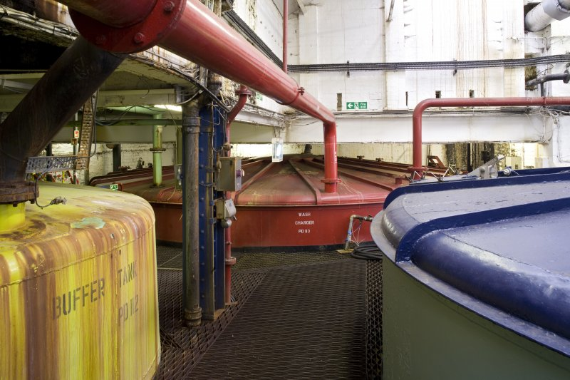 Interior. Tun room 2, view of buffer tank and wash charger (PD113). The wash charger supplies the Still House with wash which will be distilled into alcohol.