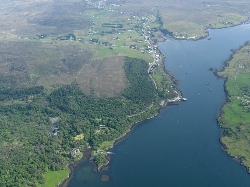 General oblique aerial view of Dunvegan castle and policies with Dunvegan beyond, taken from the N.