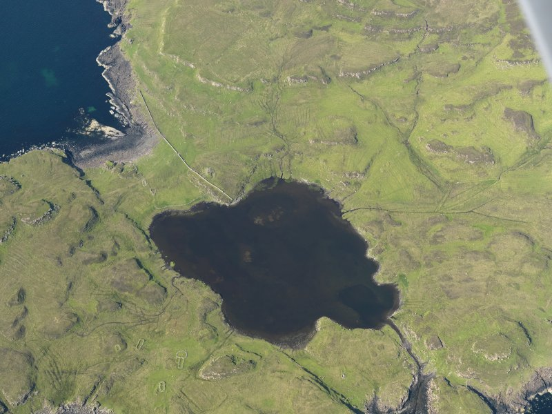 Oblique aerial view centred on the harbour at Loch na h-Airde, the 'Viking Canal' and Rubh' an Dunain, taken from the S.