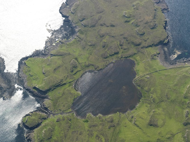 Oblique aerial view centred on Loch na h-Airde, the 'Viking Canal' and the remains of the dun at Rubh' an Dunain, taken from the E.