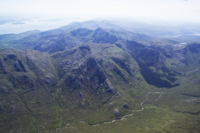 General oblique aerial view looking across Creach Bheinn with Loch Linnhe and Lismore beyond, taken from the NW.