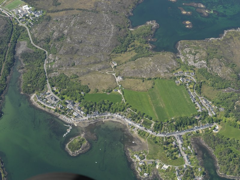 Oblique aerial view centred on Plockton village with the fish traps and kelp grid adjacent, taken from the E.
