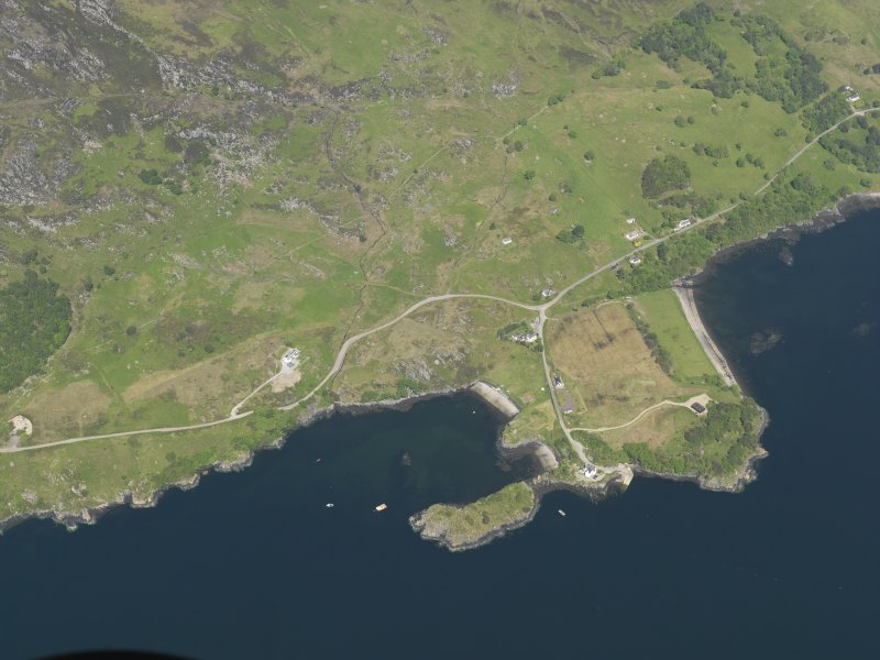 Oblique aerial view centred on the remains of Strome Castle, taken from the S.