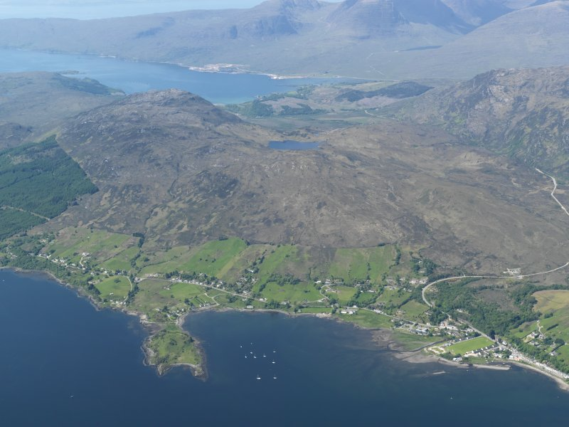 General oblique aerial view looking across Lochcarron village, taken from the E.