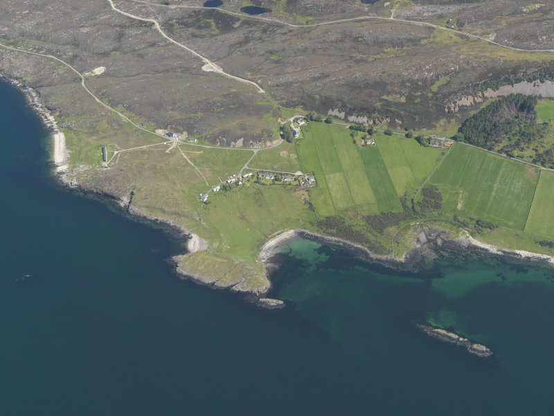 Oblique aerial view of Oskaig Point, the crofts and the possible fish trap, taken from the W.