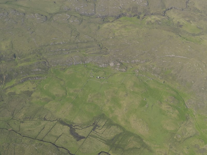 General oblique aerial view of the remains of the township, buildings and field system at Glendrian, taken from the SW.
