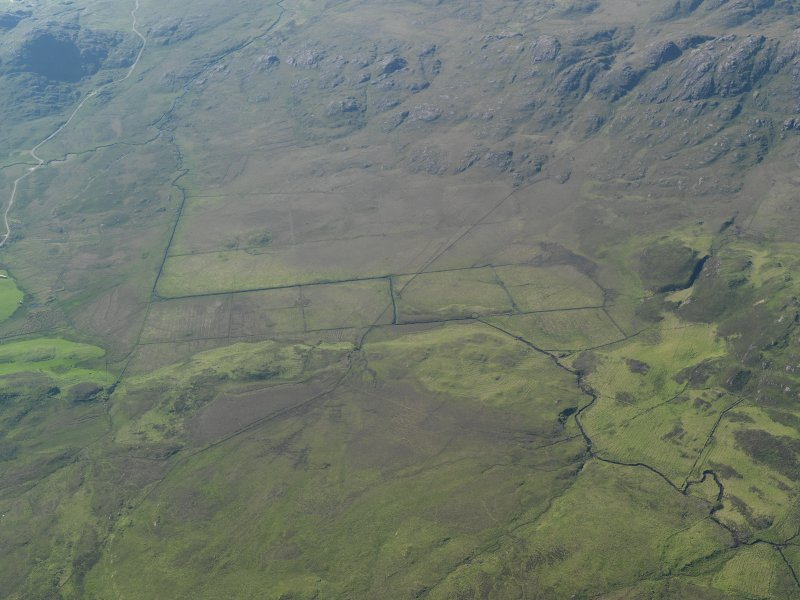 General oblique aerial view of the relict field grid-pattern boundaries, taken from the ESE.