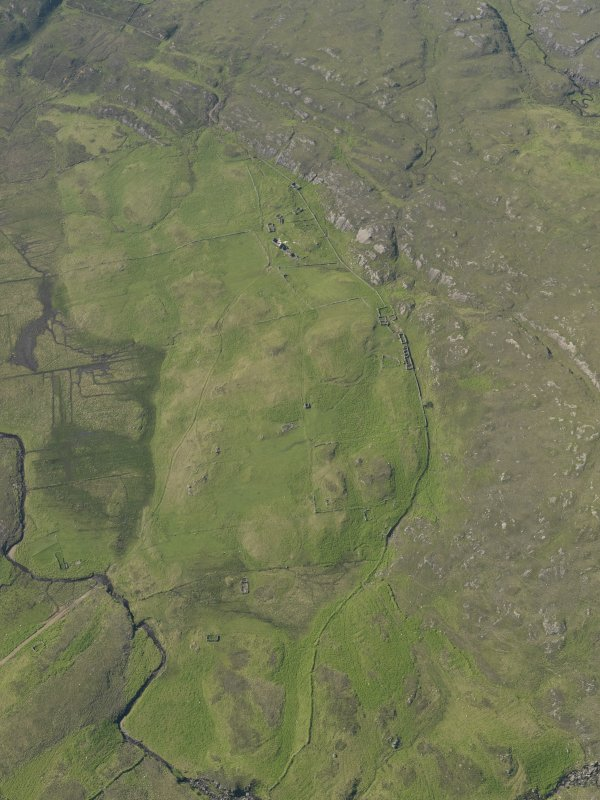 General oblique aerial view of the remains of the township, buildings and field system at Glendrian, taken from the SSE.