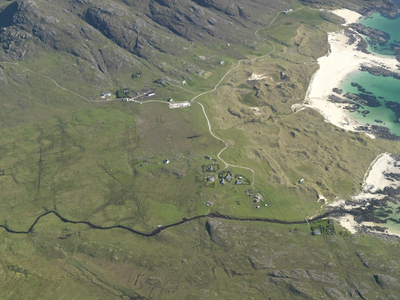 General oblique aerial view of Sanna township, taken from the N.