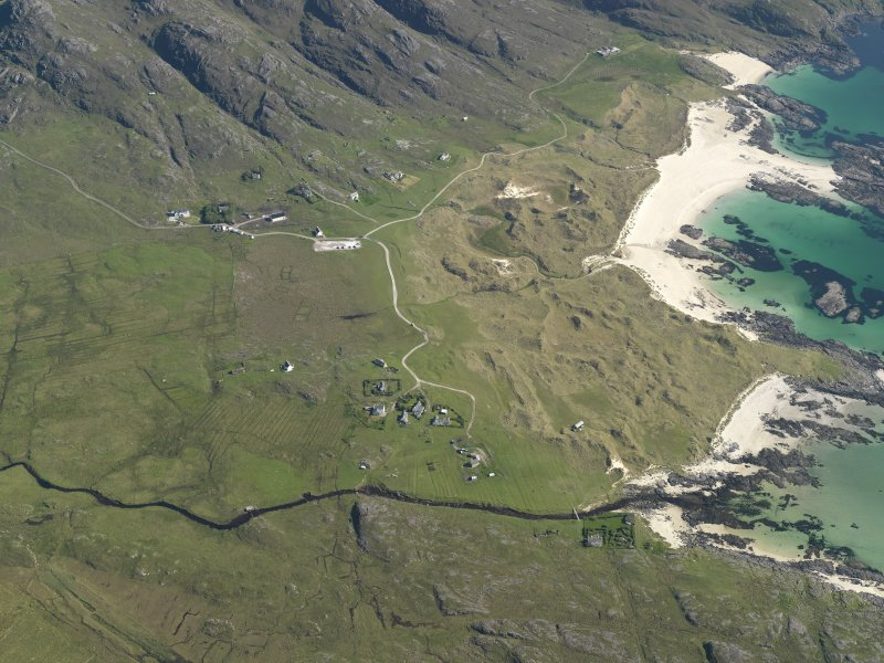 General oblique aerial view of Sanna township, taken from the NNW.