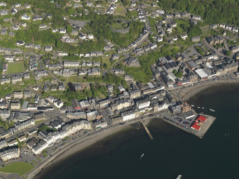 General oblique aerial view of Oban centred on the pier, taken from the WNW.