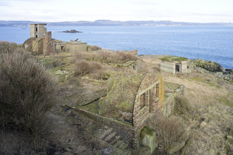 View from S shoing collapsed huts with No.2 gun emplacement and Battery Observation Tower.