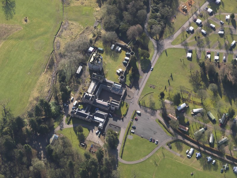 Oblique aerial view centred on the country house with the caravan park adjacent, taken from the NNW.