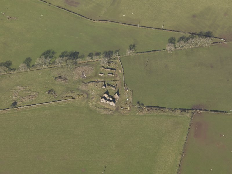 Oblique aerial view centred on the remains of the farmstead, taken from the E.