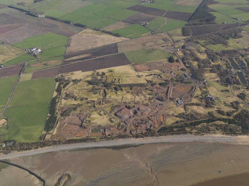 General oblique aerial view centred on the remains of the Ordnance Factory, taken from the S.