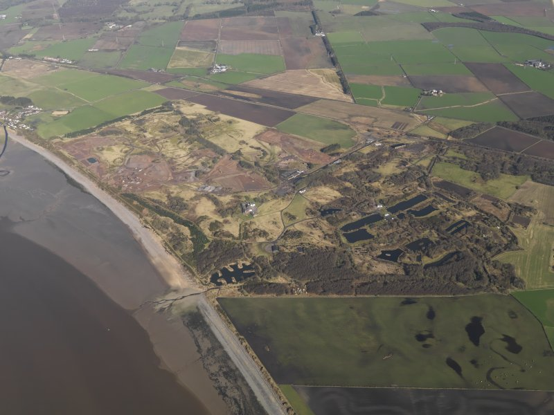 General oblique aerial view centred on the remains of the Ordnance Factory, taken from the SE.