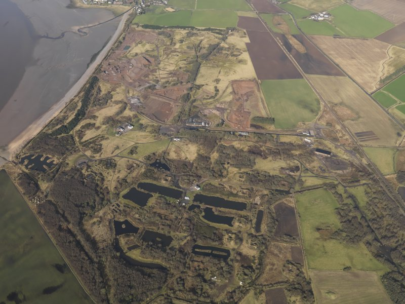 General oblique aerial view centred the remains of the Ordnance Factory, taken from the NE.
