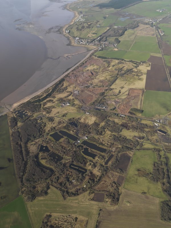 General oblique aerial view centred the remains of the Ordnance Factory, taken from the ENE.