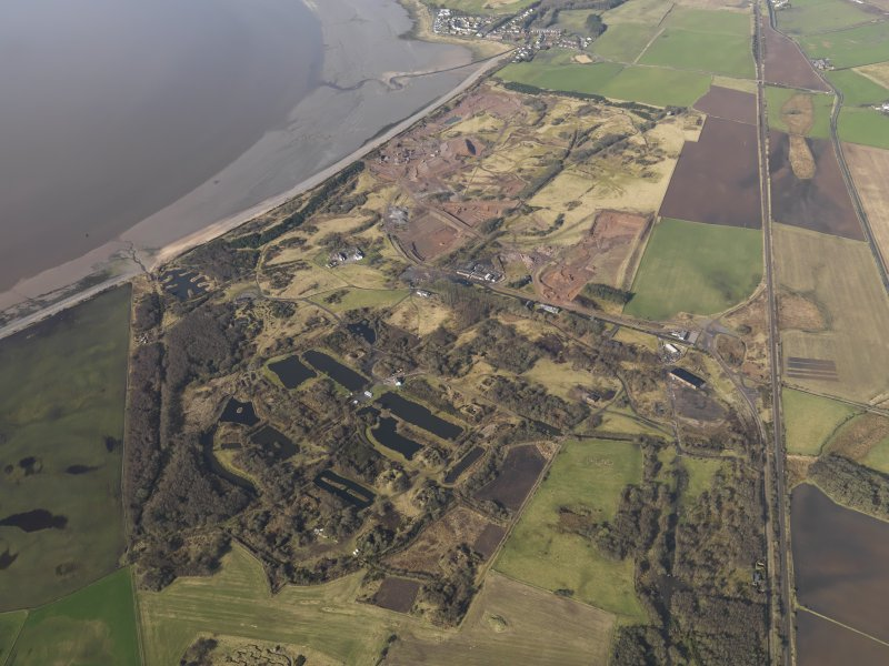General oblique aerial view centred the remains of the Ordnance Factory, taken from the