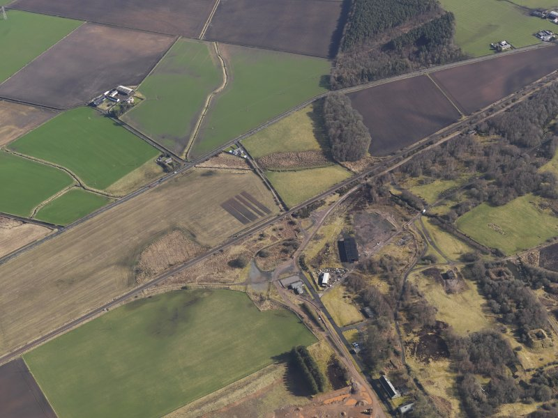 Oblique aerial view centred on part of the remains of the Ordnance Factory, taken from the SW.