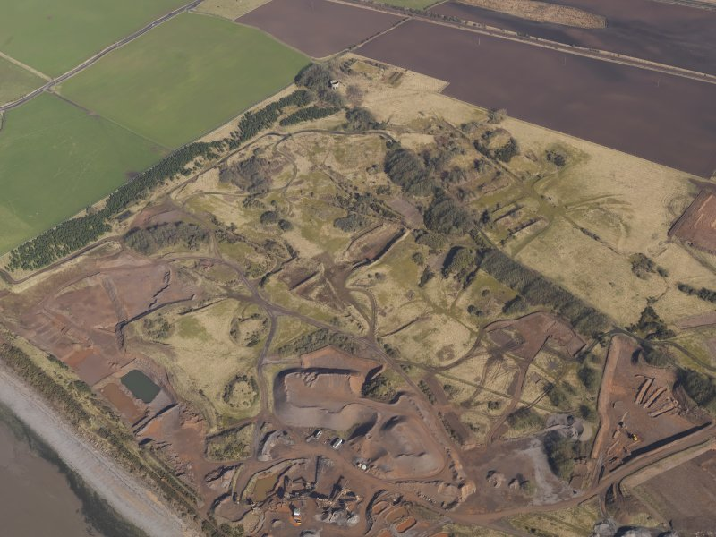 Oblique aerial view centred on part of the remains of the Ordnance Factory, taken from the SE.